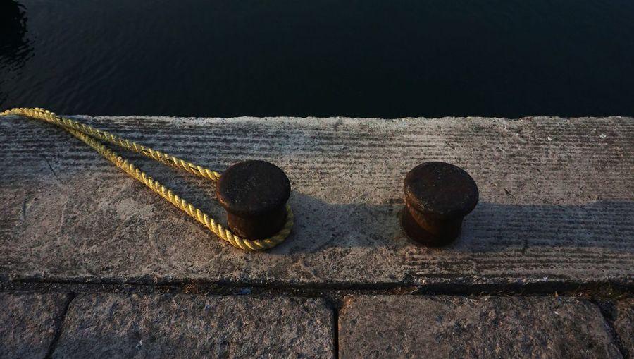 High angle view of rusty metal on wood
