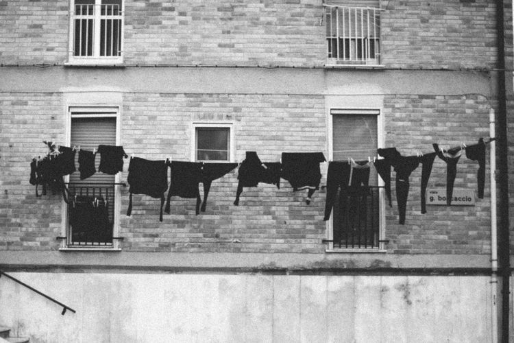 Clothes drying against building