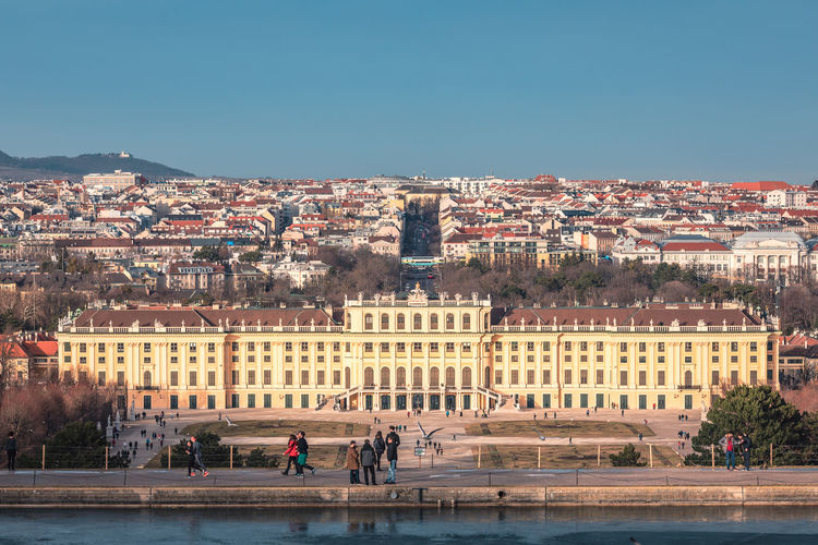 Schönbrunn Palace in golden afternoon light and the city and vineyards of Vienna in the background Building Exterior Architecture Built Structure Group Of People Building Nature Crowd Real People Sky Clear Sky Women Residential District Day Town Lifestyles Copy Space Outdoors Cityscape Schönbrunn Schönbrunn, Vienna Austria Palace Empress Sissi Sissi's Palace