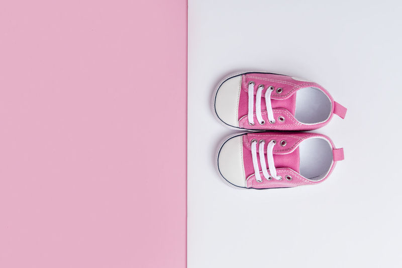 Cute pink baby girl sneakers close up on pink and white background Foot Jeans Shoe Calendar Footwear Two Sentimental Pink Feminine  Kid Wear Childhood Born Family Sport First Fashion Booties Baby Newborn Clothes Pair Blue Denim Birthday Pregnant Parenting Shopping Sneaker Soft Casual Trendy Symbol Infant Motherhood Toddler  New Pregnancy Clothing Style Card Child Space For Text Tiny Birth Girl Month Background Small Pink Color Indoors  Copy Space Directly Above No People Close-up Studio Shot Still Life High Angle View Red Technology Communication Plastic Container Connection Protection Pink Background Side By Side Representation