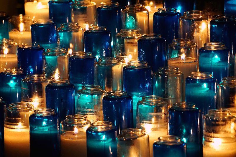 Full frame shot of lit tea light candles in church