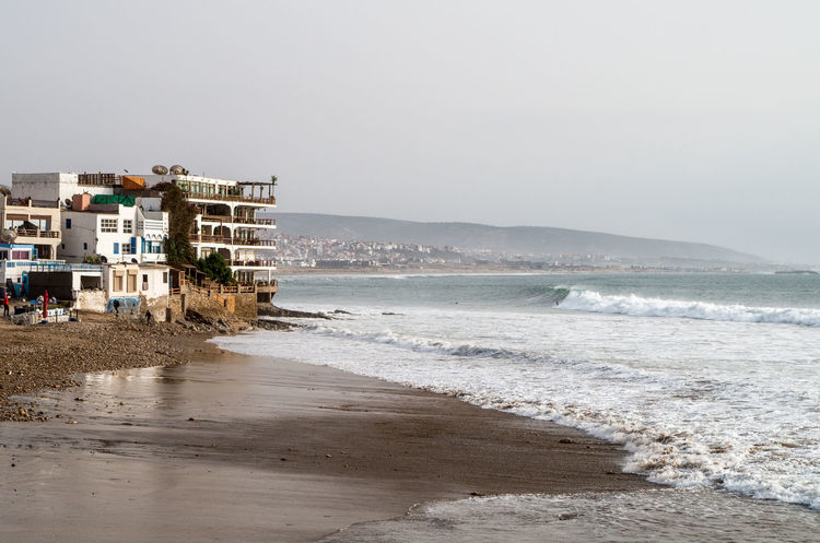 Surf Taghazout Beach Apartment Architecture Beach Building Exterior Built Structure City Day Horizon Over Water House Nature No People Outdoors Sand Sea Sky Surf Trip Surfing Taghazout Taghazout Surfing Travel Destinations Water Water's Edge Wave