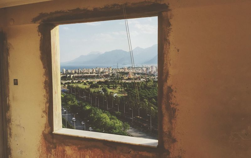View of landscape seen from stone window frame