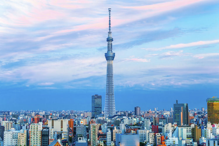 Tokyo sky tree tower in city against cloudy sky