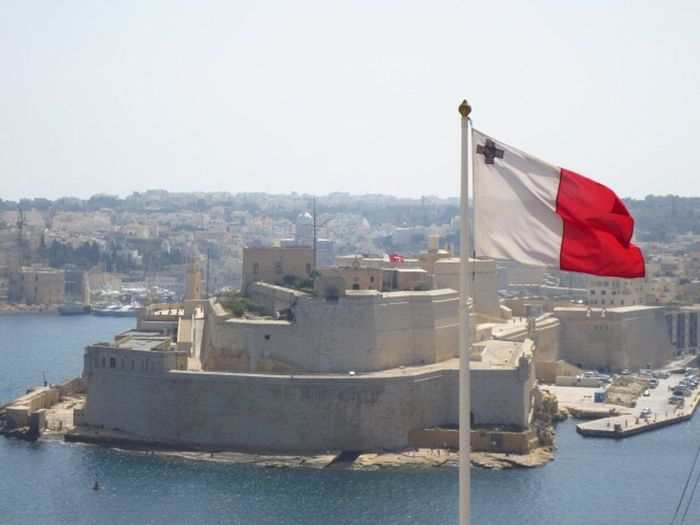 Malta- The Grand Harbour picturing a fortress structure dating back to the Knights of Malta Patriotism No People Water Outdoors Architecture Day Flag sea harbour fortress