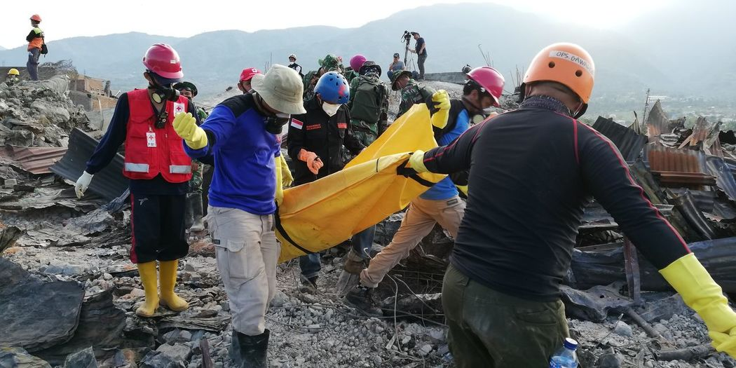 A body pulled out in a search mission in Balaroa area in Palu, capital of central Sulawesi province in Indonesia on Friday Oct 5, 2018, a week after a magnitude 7.4 quake hit the city triggering a Tsunami and land liquefaction claiming thousands of lives and displacing almost 80 thousands people, a total of 10 bodies retrieved that day Earth Fault Palu Koro Fault Sismic Activity Geology Natural Disaster Victims Huawei Nova 2i Unedited Unfiltered Rescue Worker Body Bag Dead Body Dead Body In Body Bg Earthquake Palu Central Sulawesi Balaroa Tsunami Land Liquidfaction Livelihood Natural Disaster Emergency Services Sar Search And Rescue Palu Earthquake And Tsunami 2018