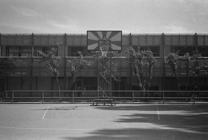 God's Playground Analog Analog Photography Analogue Photography Architecture Basketball Basketball - Sport Basketball Hoop Black And White Blackandwhite Building Exterior Built Structure Court Day Grain No People Outdoors Playground Sky