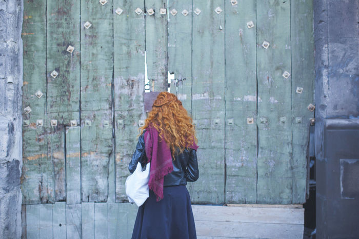 Casual Clothing Curiosity Curious Femininity Front View Girl Lifestyles Long Hair Long Hair, Don't Care. Looking In Old Buildings Old Door Old House Red Hair Skirt Standing Wall Women Young Adult Young Women