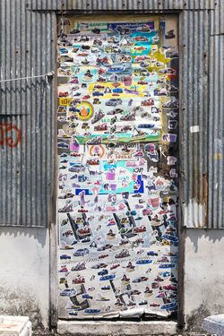 Street wall covered numerous multicolored stickers. Art And Craft Graffiti Stickers Abundance Architecture Art Art And Craft Choice Communication Creativity Day Graffiti & Streetart Graffiti Art Graffitiwall Large Group Of Objects Multi Colored No People Stickers And Stickers Stickerseverywhere Street Wall Text Variation