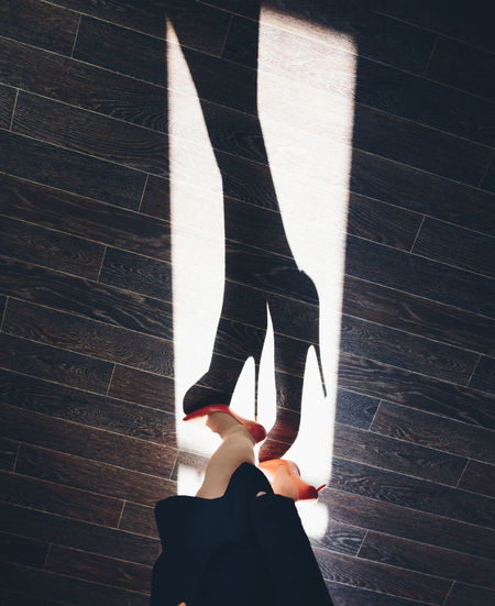 Shadow of beautiful women's feet in high heels Human Leg Human Body Part Women Standing Indoors  Lifestyles Shoe Shadow Body Part High Angle View Wood Hardwood Floor Human Foot Dancing High Heels Elégance Light And Shadow Light My Best Photo 17.62° International Women's Day 2019 Springtime Decadence