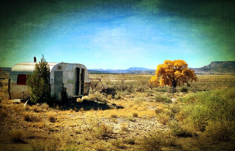 """""""Once Upon A Time In San Fidel"""" An abandoned, dilapidated old trailer sits on a vacant lot brightened only by a touch of Autumn splendor on a back road of San Fidel, New Mexico. New Mexico New Mexico Photography Fall Colors Fall Beauty Fall Autumn colors Autumn Abandoned And Derelict Old Trailer Abandoned Trailer Sky Land No People Landscape"""