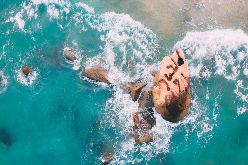 Water Sea Motion High Angle View Nature One Person Swimming Real People Lifestyles Leisure Activity Young Adult Beauty In Nature Day Splashing Sport Young Men Men Wave Outdoors Turquoise Colored Swimming Pool