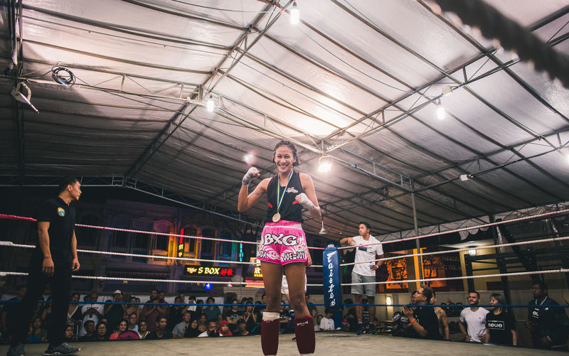 Achievement. International Women's Day 2019 Real People Lifestyles People Adult Women Sport Crowd Boxing - Sport Boxing Ring Winner Sportswoman Young Woman Woman Muay Thai Fight