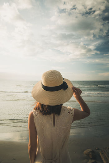 Hey, you. Capture The Moment Colors Enjoying The View Exploring Hat Nature Taking Photos Tranquility Travel Travel Photography Beach Beauty In Nature Cloud - Sky Enjoying Life Landscape Light And Shadow Model Ocean One Person Outdoors Sea Sunset Travel Destinations Tropical Waterfront
