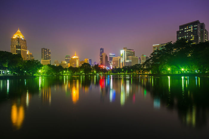 Lumphini Park ,Bangkok Lumphini Lumphini Park Thailand Lumphini Park Architecture Building Building Exterior Built Structure City Cityscape Financial District  Illuminated Landscape Modern Nature Night No People Office Building Exterior Outdoors Purple Reflection Sky Skyscraper Tall - High Urban Skyline Water Waterfront