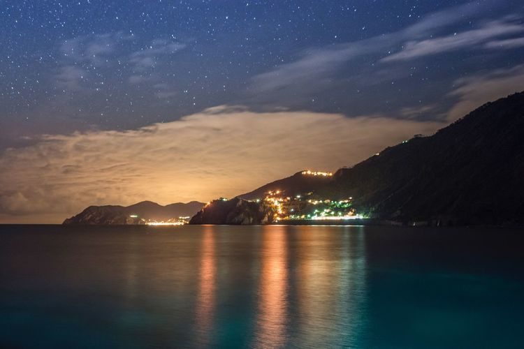 Night view of the genoa lights and coast from manarola