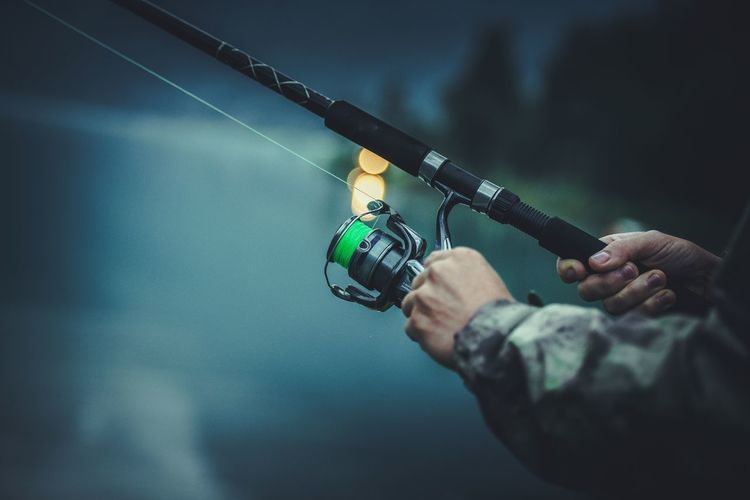Late Fly Fishing. Angler with Fishing Rod in Hands. Closeup Photo. Fly Fishing Fisherman Fishing Rod Human Hand Real People Fish Lake Evnei Holding Hand Men