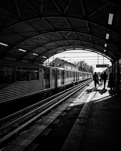 Transportation Railroad Station Railroad Station Platform Railroad Track Public Transportation Real People Day City Streetphotography Berliner Ansichten Bnw Monochrome Photography Monochrome Blackandwhite Blackandwhite Photography Black And White Black & White Street Photography Light And Shadow City Life Mode Of Transport Ubahn Shadow