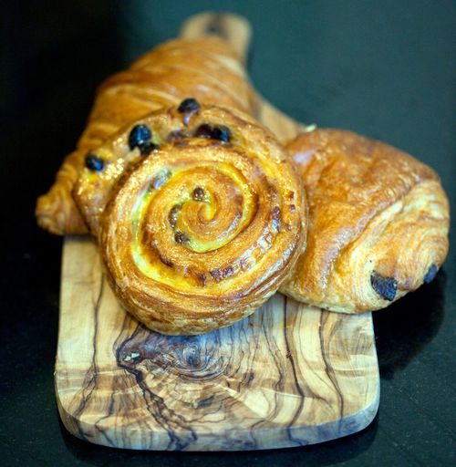 Close-up of pain aux raisins served on table