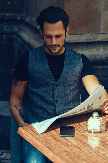 Young Businessman reading Newspaper Bearded Black Hair Break Businessman Cafe Lifestyle Light And Shadow Male Men Mensfashion Menstyle Mobile Phone Model Moustache Newspaper Outdoor Reading Reading Newspaper Relaxing Moments Smart Style And Fashion Sunlight Business Stories