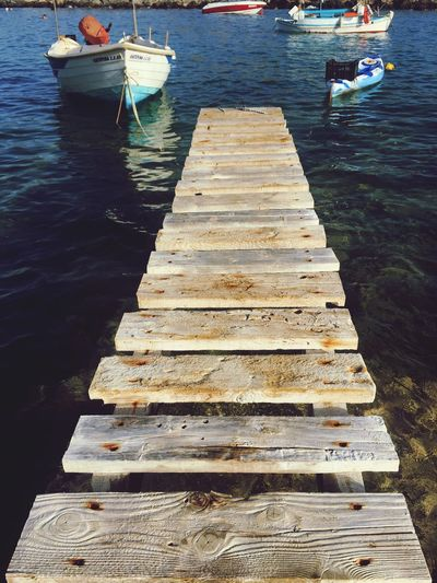 Water Wood - Material Nautical Vessel Nature Transportation Mode Of Transport Day Outdoors No People Lake Beauty In Nature Wood Paneling Water Ramp Islandlife Boat Boat In Water Boating Boats⛵️ Crete Greece Boats On The River Moored Mooring Rope Summer