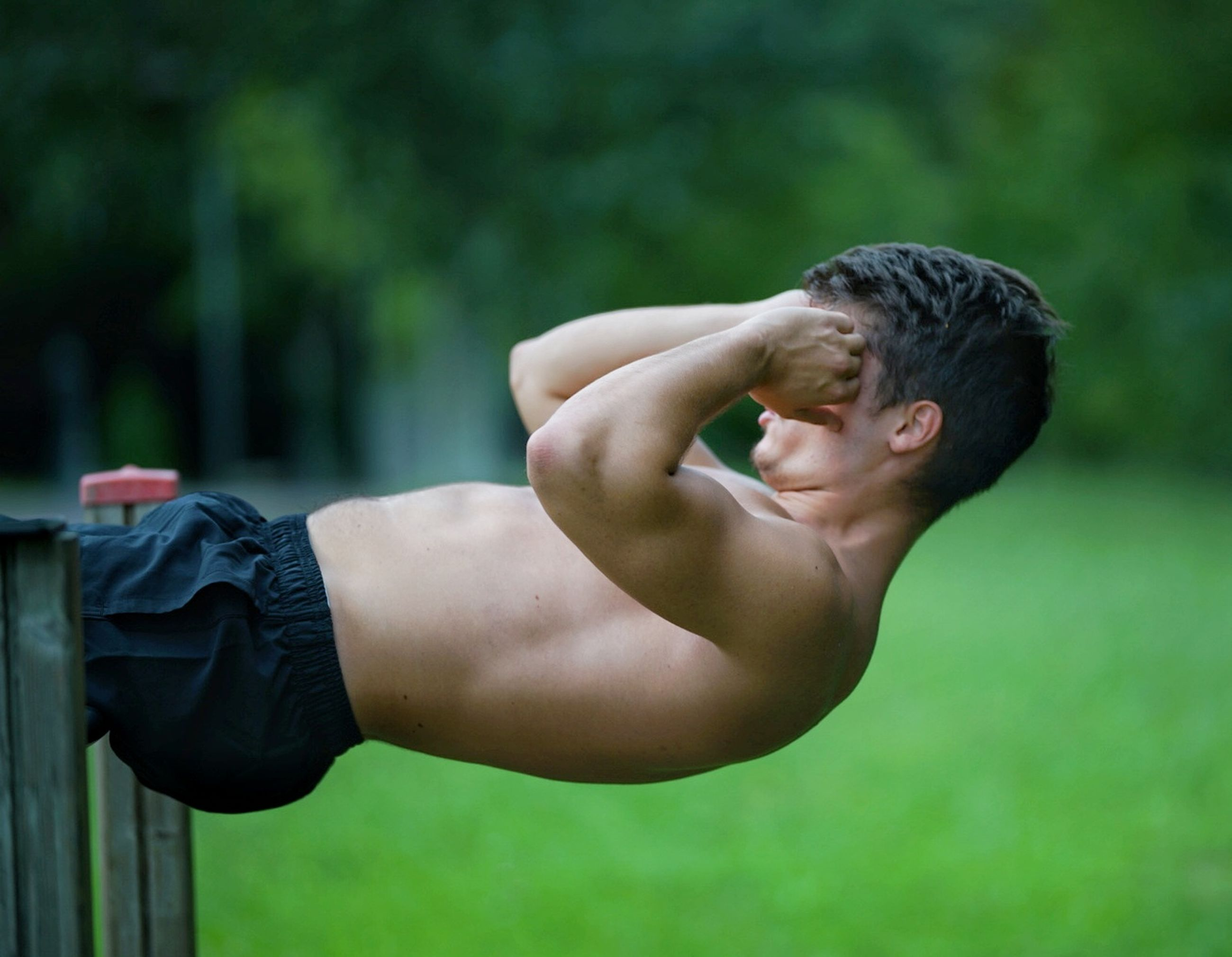 one person, real people, lifestyles, focus on foreground, day, shirtless, men, plant, nature, males, strength, young adult, exercising, healthy lifestyle, young men, green color, leisure activity, muscular build, human body part, effort