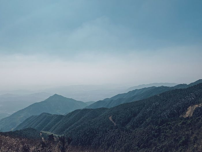 High angle view of mountain range against cloudy sky