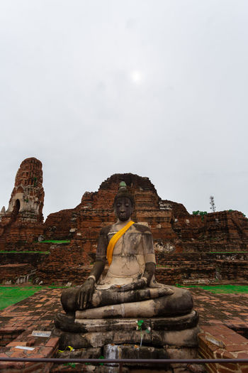 Statue of historic temple against sky