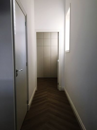 Architecture Door Entrance Building Corridor Indoors  Arcade No People Wall - Building Feature Security Closed Flooring Illuminated Built Structure The Way Forward