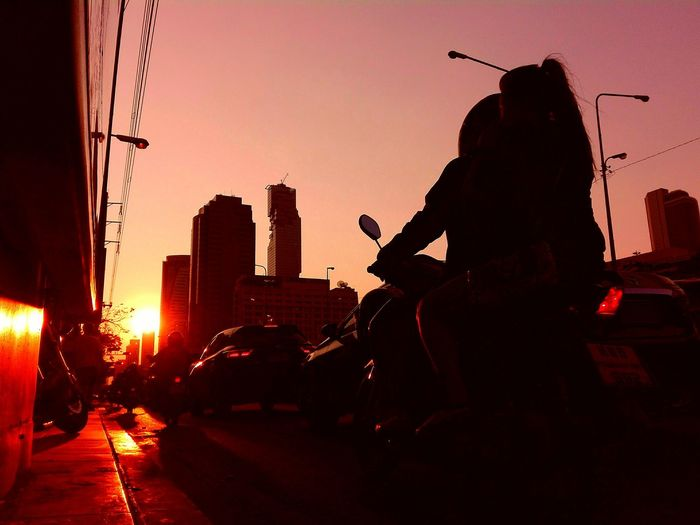 The City Light Silhouette One Man Only People Tow People Outdoors City Life Red Light Sunset_collection Motorcyclepeople Shiny Silhouette EyeEm Gallery Sunset Transportation Illuminated Lighting Equipment City Low Angle View Blackground Collection Eyeemphotography Skyscraper Mode Of Transport