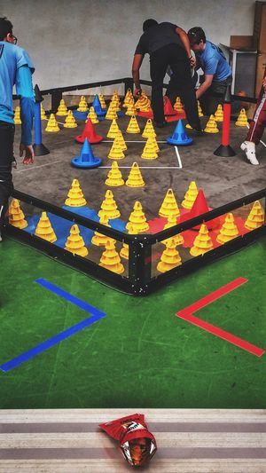 The Pit✨🤖✨ ... robot training corral✨😄 Colorful Cones Taking Photos Tadaa Community Robotics Real People Low Section Men Women Lifestyles Human Leg Leisure Activity High Angle View