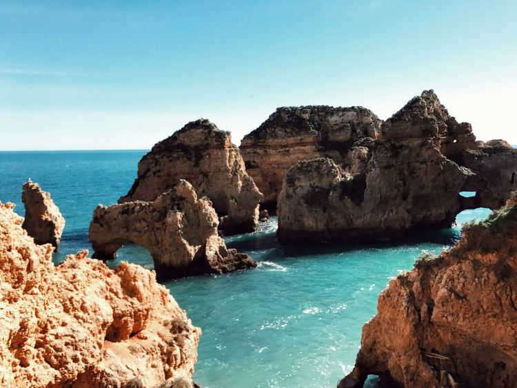 Piedade Ponta Da Piedade Lagos Algarve Portugal Sea Nature Blue Water Beauty In Nature Scenics Rock - Object Rock Formation Tranquil Scene Clear Sky Tranquility Day Horizon Over Water Outdoors Sky No People Natural Arch
