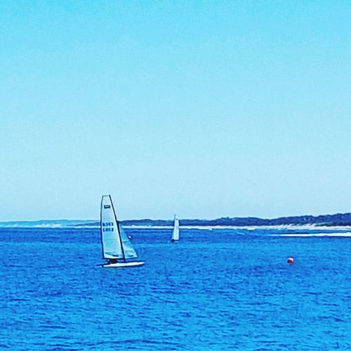 Sea Sailboat Nautical Vessel Sailing Horizon Over Water Vacations Water Beach Summer Blue Yacht Scenics Sailing Ship Travel Outdoors Travel Destinations Buoy Tranquility Transportation Day