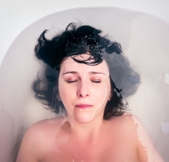 Portrait Headshot One Person Women Real People Young Adult Young Women Beautiful Woman Hair Water Lifestyles Bathtub Domestic Bathroom Bathroom Domestic Room Taking A Bath Indoors  Eyes Closed  Wet Hairstyle Human Hair