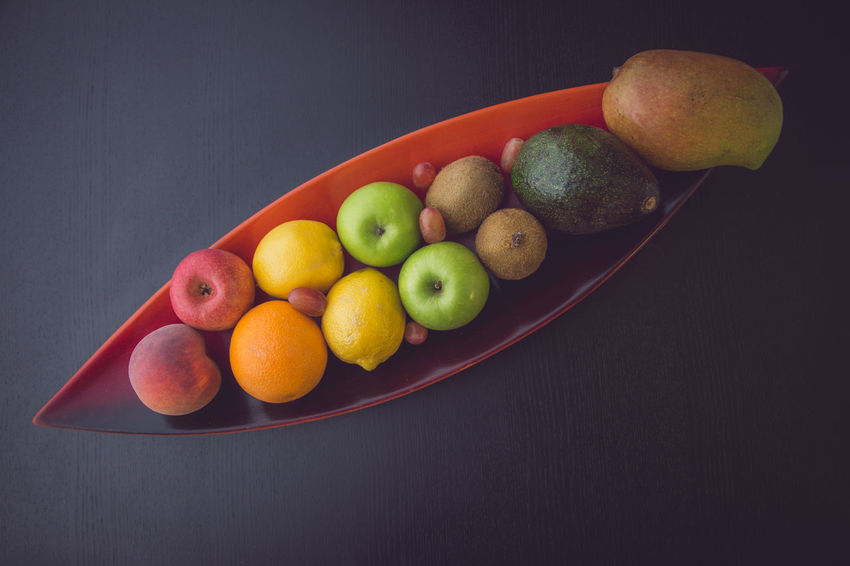 Bowl of Fruits on a Table Mango Tropical Fruits Avocado Black Background Colorful Dark Background Food And Drink Freshness Fruit Fruit Bowl Grape Healthy Eating Kiwi Fruits Multi Colored No People Orange Color Peach Still Life Studio Shot Table