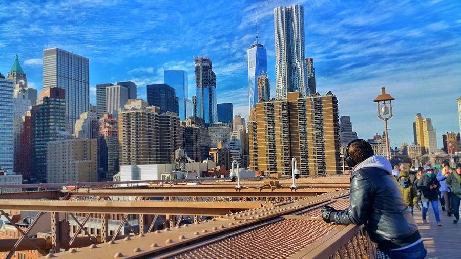 Full length of modern skyscrapers against sky in city