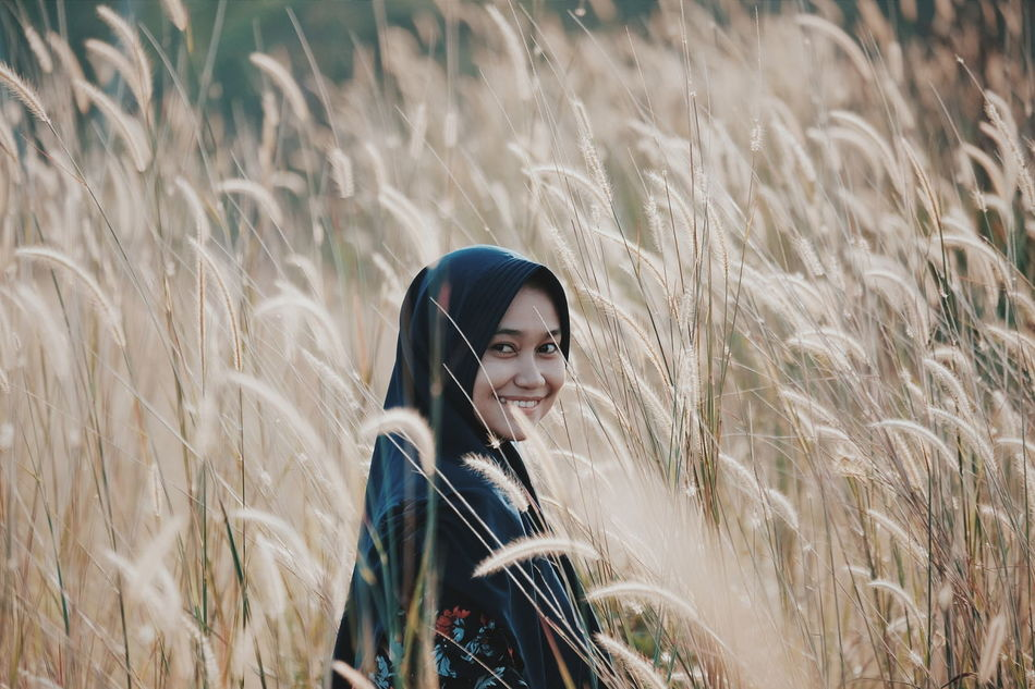 Grassy Grass Area Grass And Sky Grasses In The Wind Grassfield Grassy Field Grasses And Sun One Person Waist Up Portrait People Adult Standing Field Fashion Smiling Day
