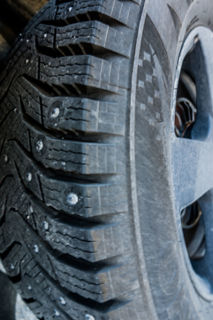 CLOSE-UP OF TIRE IN A CAR