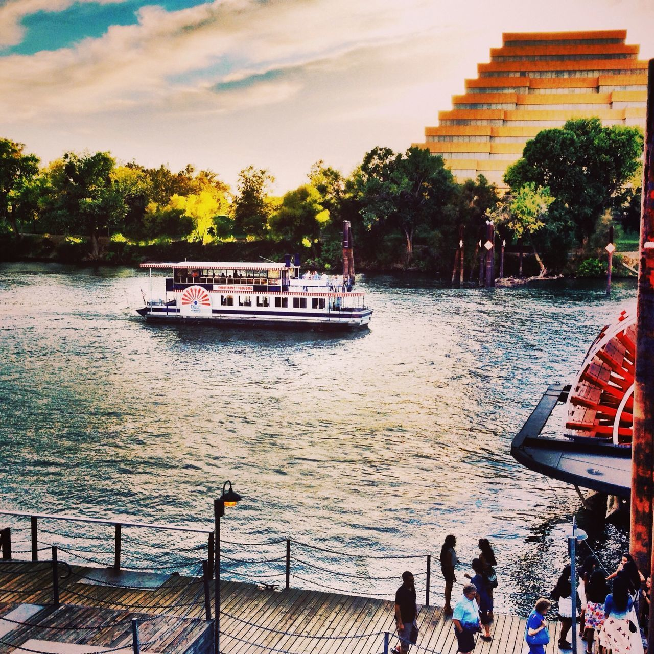 water, nautical vessel, transportation, mode of transportation, sky, real people, nature, group of people, architecture, men, built structure, tree, travel, large group of people, lifestyles, crowd, outdoors, railing, women, passenger craft