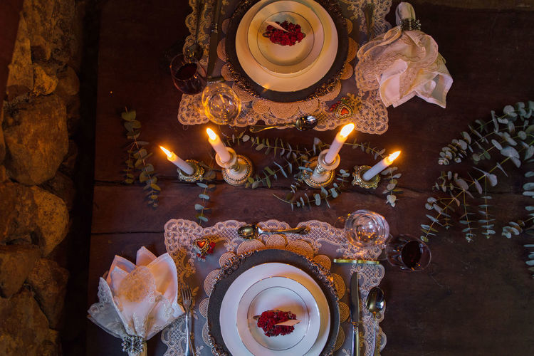 High Angle View Of Table Setting With Candles