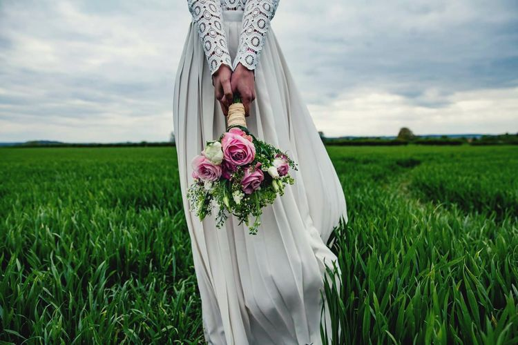 Adult Field Only Women Wedding Flower Nature Outdoors Bride Rural Scene Grass Green Color Wedding Dress Young Women Cereal Plant Sky Blue Beauty In Nature Haute Couture Desinger Magazine Nature On Your Doorstep Well-dressed Dresses Naturephotography Nature