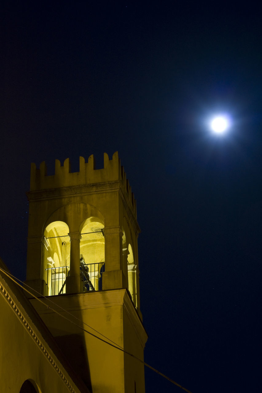 night, illuminated, low angle view, architecture, moon, built structure, sky, history, building exterior, outdoors, no people, moonlight, clear sky