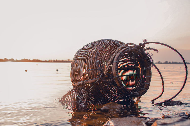 Traditional rattan woven fishing creel basket left behind in the rising tide