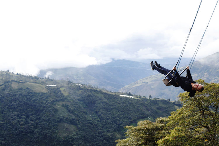 Baños Ecuador Adventure Mountain Extreme Sports RISK Sport Scenics - Nature One Person Men Rope Nature Day Real People Leisure Activity Sky Tree Warning Sign Sign Activity Communication Mountain Range Safety Harness Outdoors Swing