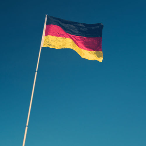 Flag Blue Patriotism Low Angle View Sky Nature No People Day Yellow Pride Clear Sky Red Wind Pole Environment Copy Space Waving Outdoors National Icon German Flag Germany🇩🇪 National Flag Black Red Gold Colored