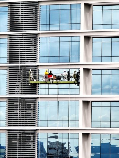People working by modern building