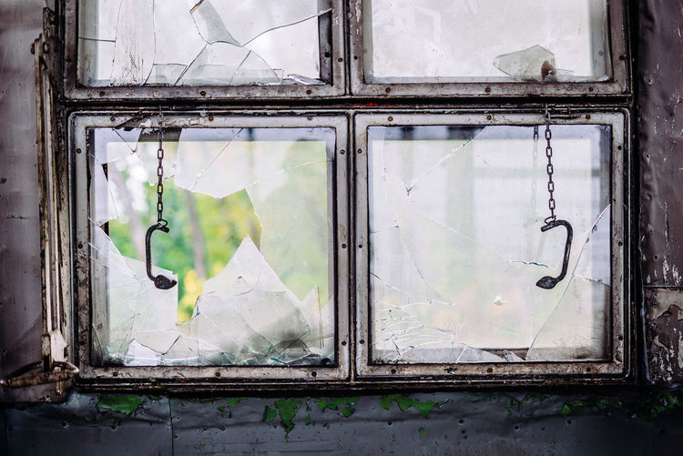 Window Glass - Material Damaged No People Broken Abandoned Architecture Day Bad Condition Old Obsolete Built Structure Run-down Deterioration Decline Weathered Transparent Shattered Glass Outdoors Reflection Ruined Window Frame