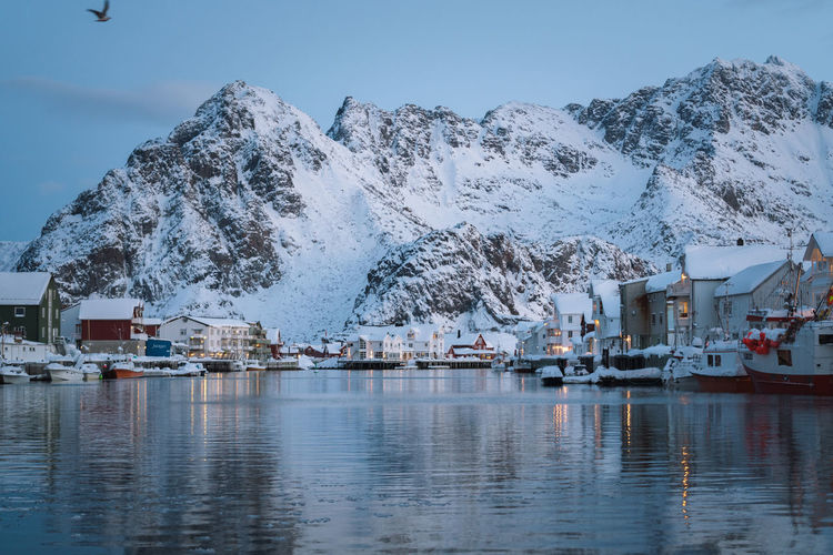 Check out my prints at https://simonmigaj.com/shop/ and visit my IG http://www.instagram.com/simonmigaj for more inspirational photography from around the world. Travel Cold Norway Harbour Lofoten Reflection Fjord Village Fishing Landscape Water Mountain Nautical Vessel Snow Sea Snowcapped Mountain Winter Cold Temperature Sky Mountain Range Harbor Boat Marina Moored