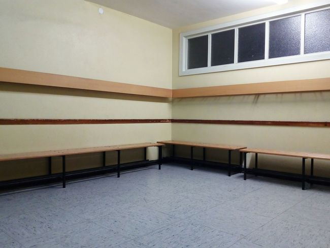 changing room in a gym sports center Changing Room Bank Wall Window Gym Sports Center Architecture Built Structure Staircase Indoors  No People Museum Prison