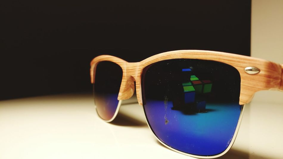 My old sunglasses 🤔 and a 6x2x2 rubix cube 🎲 (wich is unsolvable)Reflection Eyesight Close-up Eyeglasses  No People Illuminated Indoors  Technology Day Fragility Blurry First Eyeem Photo Human Body Part People One Man Only Black Background Reflection Blue Cold Temperature Bridge - Man Made Structure Red Nofilter Architecture Flower Freshness EyeEmNewHere